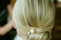 04 a twisted low bun with pearl pins and a sleek top for a modern take on a traditional look