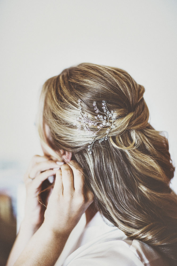 Her hairstyle was a simple and elegant wedding updo with a rhinestone headpiece