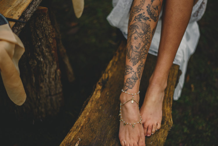 Her leg tattoos were highlighted with chain anklets