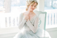 05 Her wedding dress was a frosty blue one, with a layered skirt, a lace and embellished bodice, a V-neckline and long sleeves
