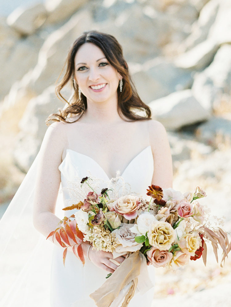 The bridal bouquet was one in the shades of peach, mauve, coral, burgundy and blush and looked very delicate
