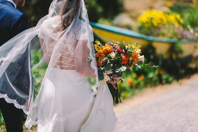 The bridal bouquet was rather wild and colorful, orange, yellow and pink blooms were incorporated