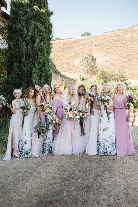 The bridesmaids were wearing blush, mauve and floral print dresses, they were mismatching but done in one style