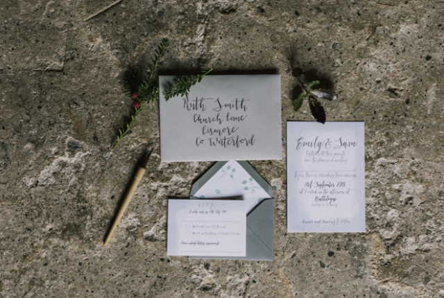 The wedding invitation suite was done in the shades of gre and with dark calligraphy