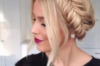 05 a fishtail braid updo with some locks down is a very trendy and fashionable option