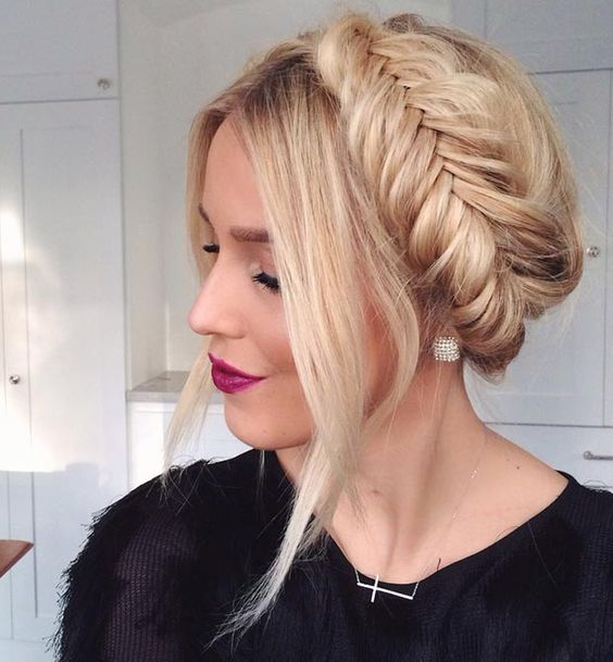 a fishtail braid updo with some locks down is a very trendy and fashionable option