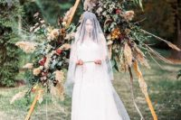 05 a gorgeous fall boho wedding arch with pampas grass, leaves, herbs and fall leaves for a textural look