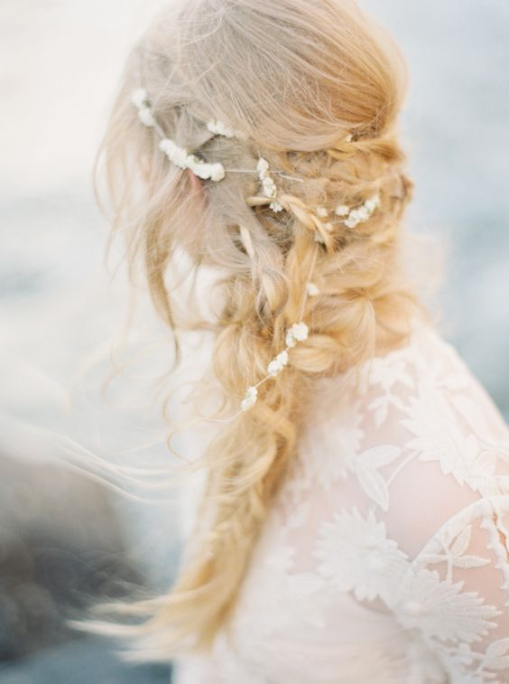 a messy layered braid with twists and a pearl headpiece for a coastal bride