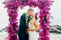 05 a super lush and bold wedidng arch of fuschia orchids and bouganvilla