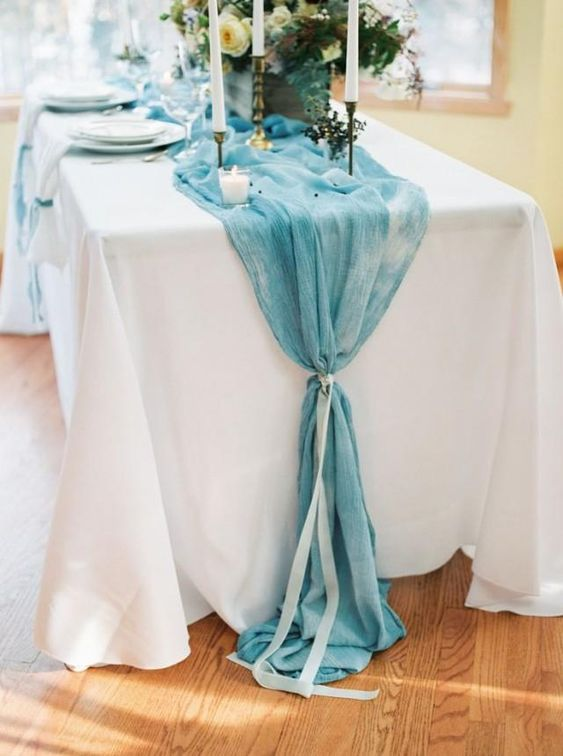 a watercolor blue table runner with a ribbon for a something blue touch or a romantic watercolor touch