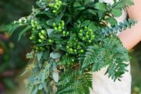 05 all-green cascading wedding bouquet with ferns and eucalyptus and berries for a chic woodland look