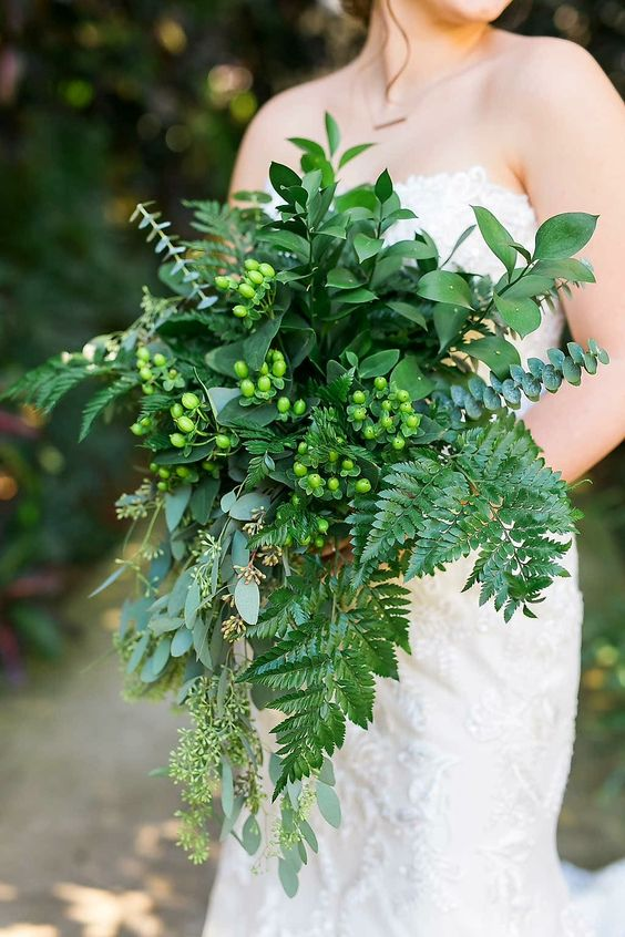 all-green cascading wedding bouquet with ferns and eucalyptus and berries for a chic woodland look