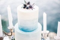 05 an ombre blue wedding cake decorated with blue thistles and blueberries for a sea feel