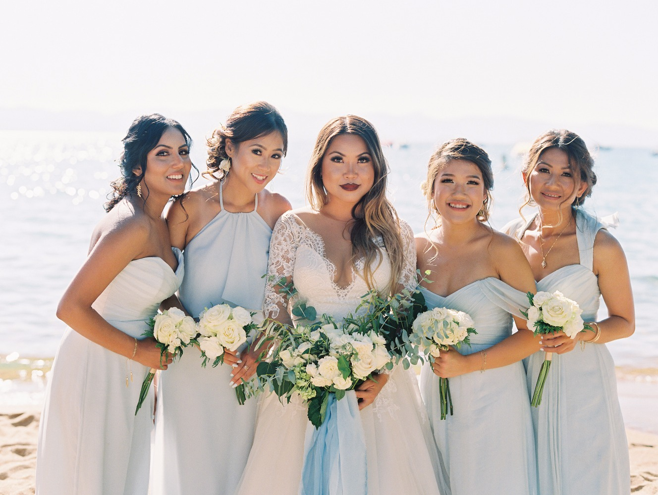 elegant mismatching off white gowns and a strapless white one for the maid of honor