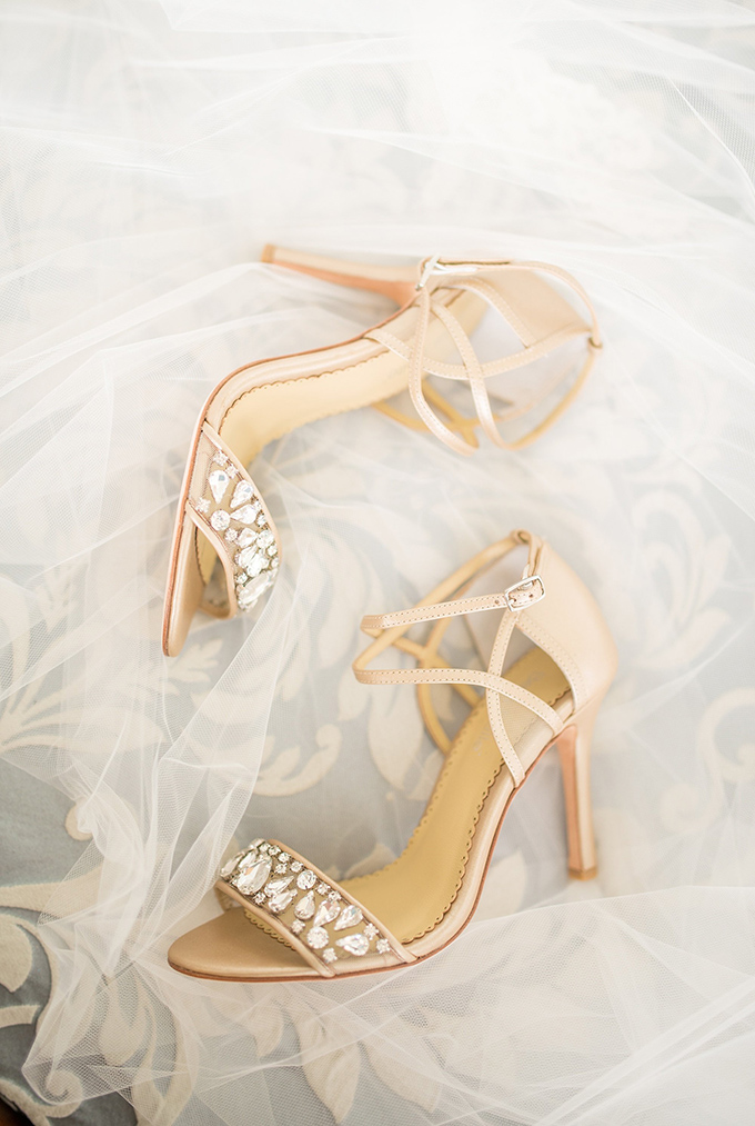 She was wearing blush shoes with embellishments for a glam feel