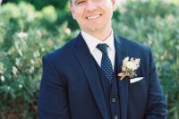 06 The groom was wearing a navy three-piece suit and a printed tie