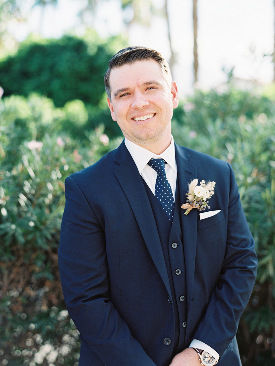 The groom was wearing a navy three piece suit and a printed tie