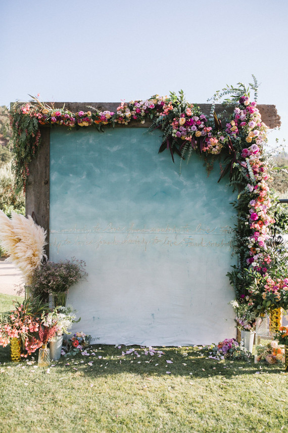 The wedding backdrop was an ombre blue one, with quotes and lush florals and greenery