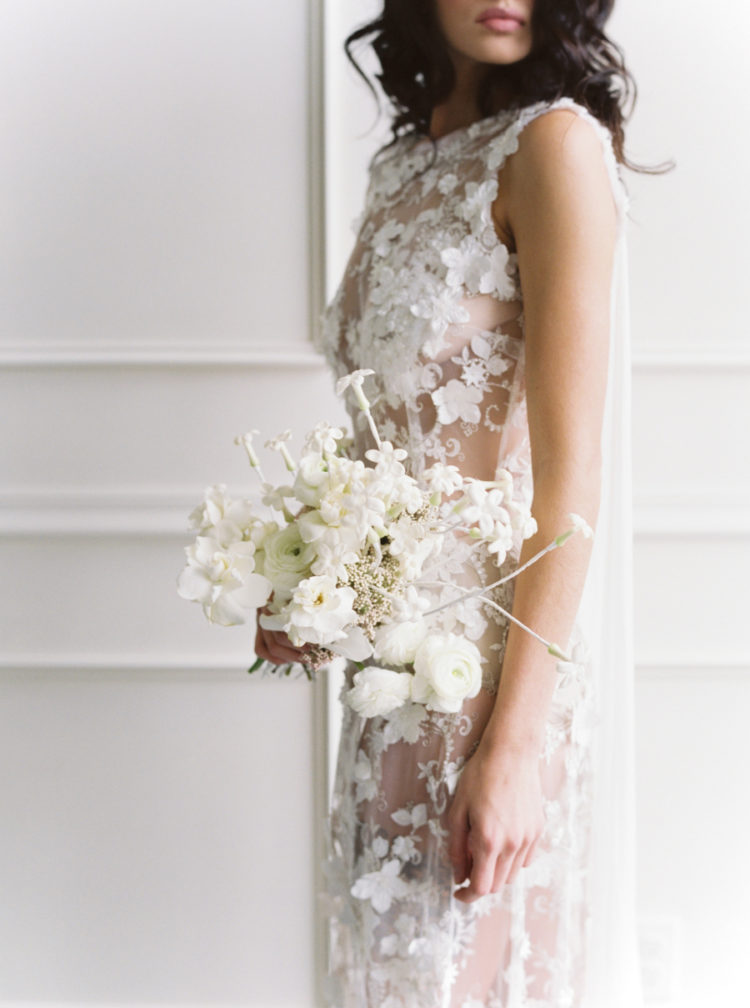 The wedding bouquet was completely white and perfectly matching the wedding dress