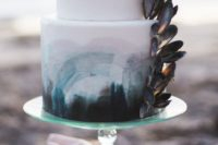 06 a bold seaside wedding cake with bold watercolor from turquoise to black and oyster shells on the side