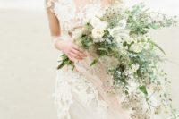06 a cascading delicate wedding bouquet with light-colored greenery, neutral blooms and herbs