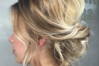06 a loose messy updo with a bouffant, waves down for a chic and casual bridesmaid's look