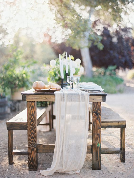a semi sheer airy fabric table runner is a great idea for any summer wedding