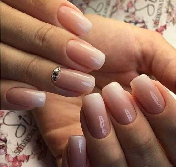 ombre French nails with some rhinestones for a glam feel and a bold look