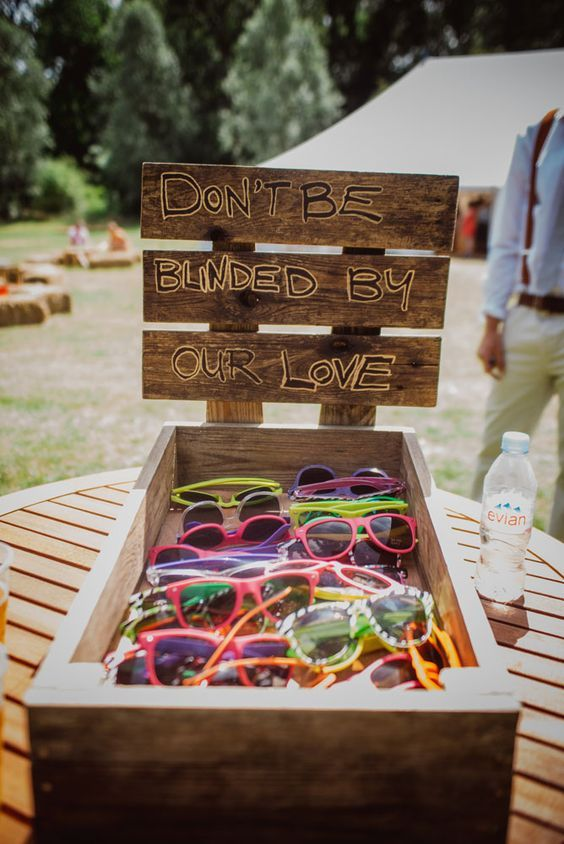 various colorful sunglasses are a great idea for a summer wedding and they will give more comfort to the guests