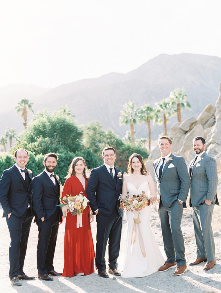 The bridesmaid was wearing a red kimono dress, and the groomsmen were rocking grey and black suits