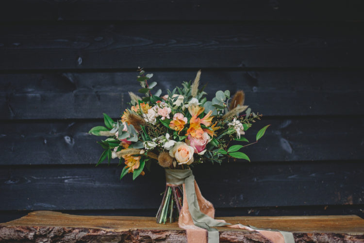 The wedding bouquet was done with herbs and orange and blush blooms