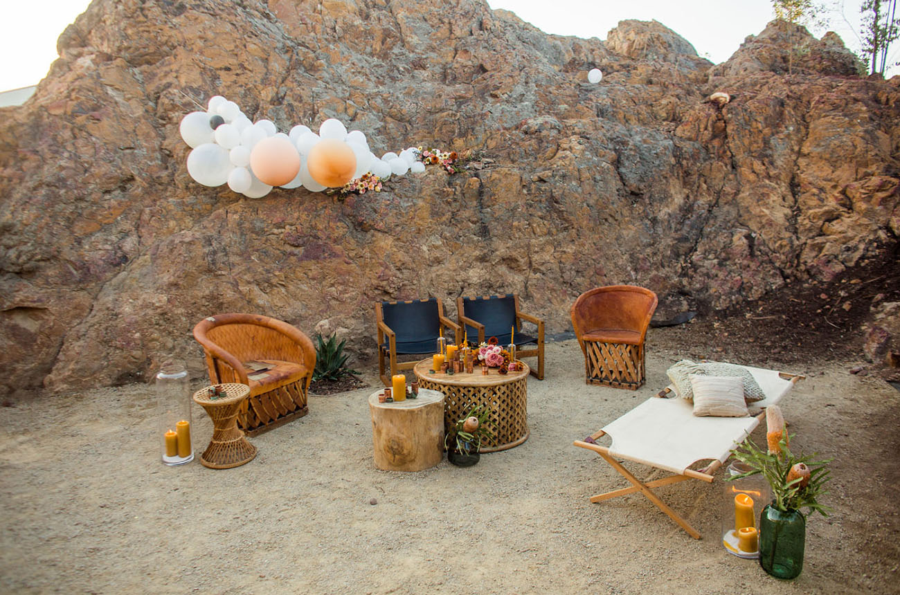 The wedding lounge was done with leather and woven furniture, plus balloons and florals
