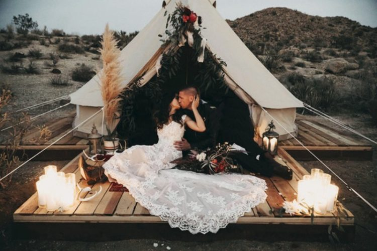 There was a teepee styled for the couple, with grass, greenery and blooms and a small deck with candles, lanterns and antlers