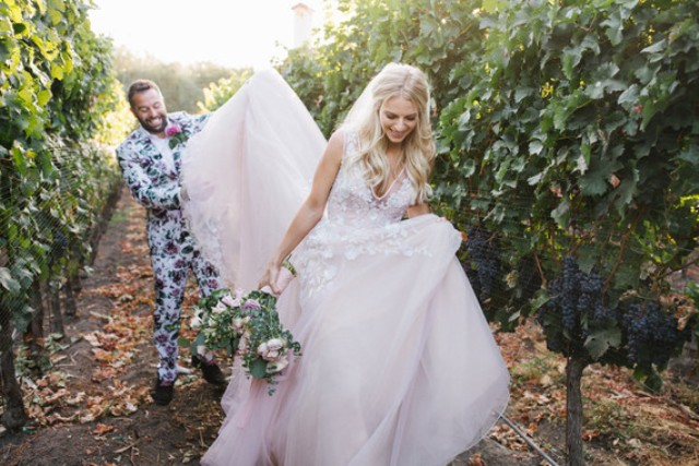 A vineyard was a perfect venue for this wedding, filled with greenery and blooms