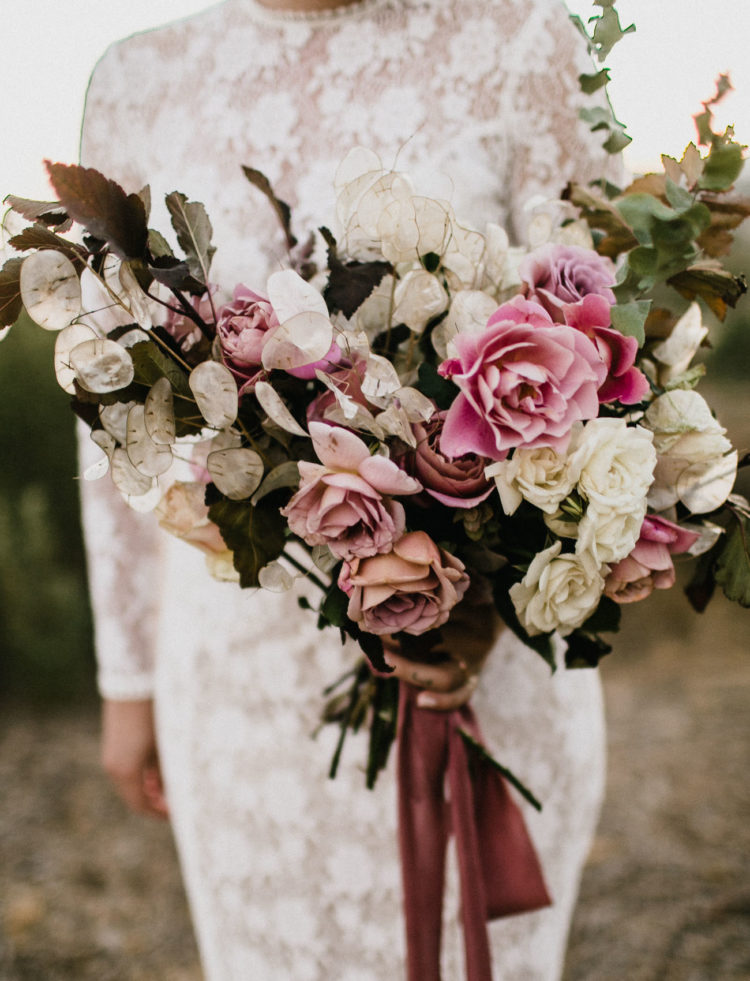 Look at the gorgeous bridal bouquet with pink roses and dusty pink ribbons