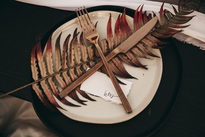 The chargers were black ones, with copper flatware and spray painted leaves
