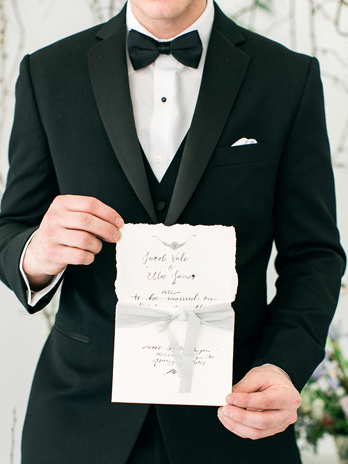 The groom was wearing a classic black tuxedo