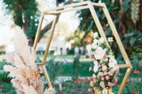 08 The wedding arbor was an octagon decorated with lush blooms and pampas grass to give it a desert feel