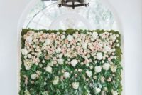 08 a lush greenery wall with some creamy and blush blooms on top to make your ceremony space feel like a garden