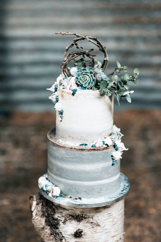 a mermaid-inspired wedding cake with urchins, meringues, succulents and branches