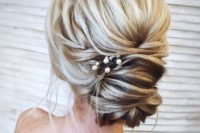 08 a messy twisted updo with pearl pins is a delicate idea for a romantic girl
