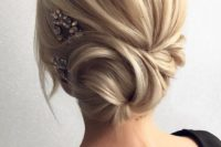 08 a side twisted low bun with some locks down and a rhinestone hairpiece on one side
