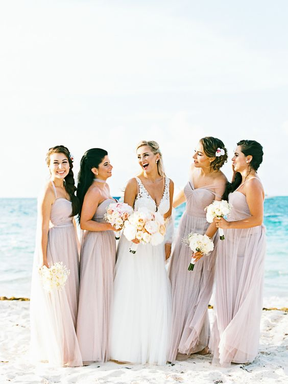 blush maxi dresses with various necklines look very tender and stand out on a white beach