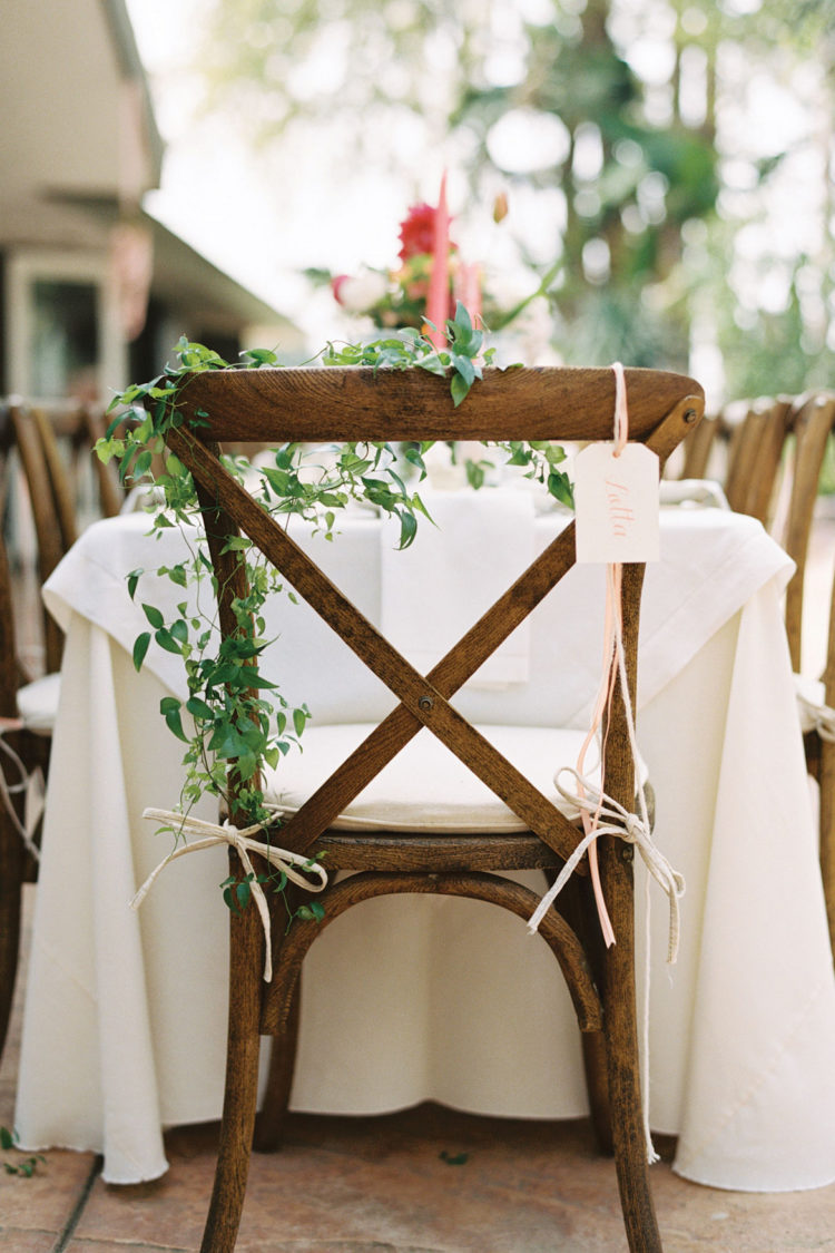 decorate the chairs with delicate greenery garlands, ribbons and tags, so you won't need any place cards