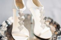 08 heeled white wedding sandals with glitter hearts look very girlish and sweet and can be your whimsy touch