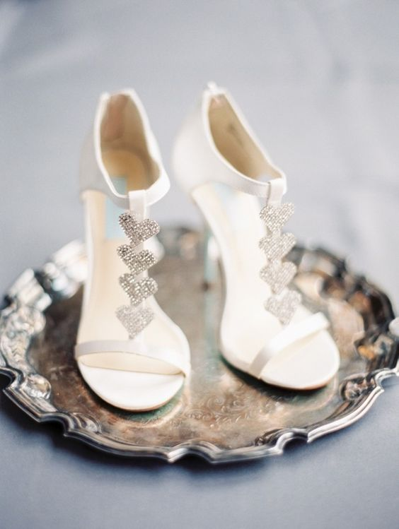 heeled white wedding sandals with glitter hearts look very girlish and sweet and can be your whimsy touch
