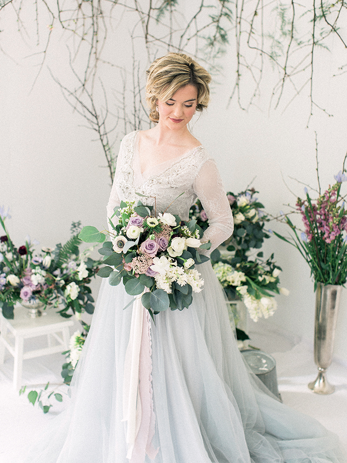 The bridal bouquet was done in lilacs and mauve plus white and greenery