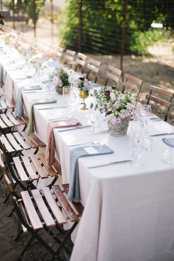 The table settings were done simple, with pastel blooms and napkins to make the wedding more floral -like