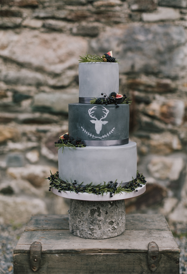 The wedding cake was a concrete one, in the shades of grey, with a deer head painted on one tier