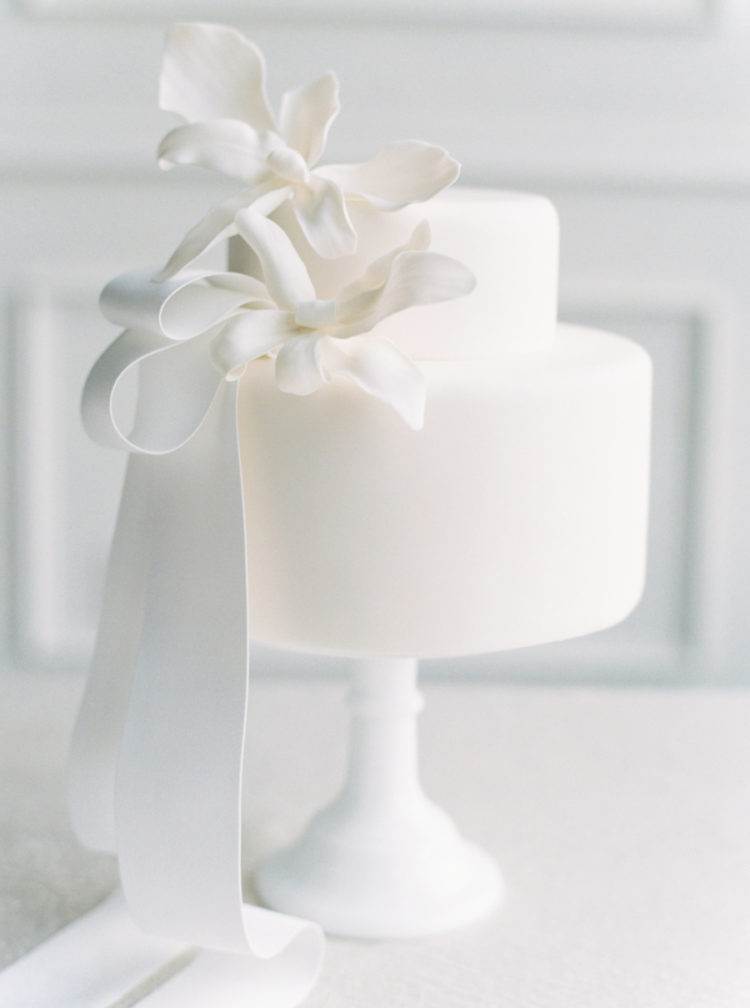 The wedding cake was purely white, with large sugar flowers on top and some ribbons